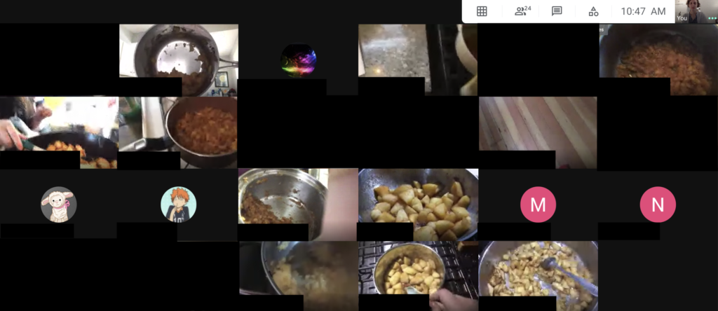 A screenshot showing a Google meeting of a classroom. About half of the students have their cameras on and are showing their progress cooking homemade applesauce.